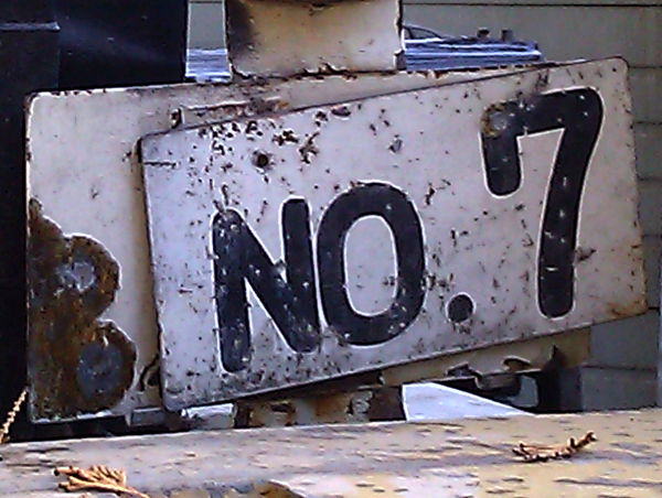 "rusty sign that reads ""No. 7"""