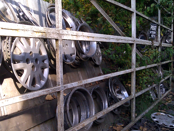 wheel covers mounted on a wall outside