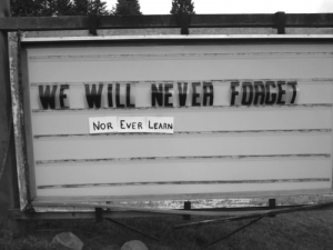 Sign: We will never forget...nor ever learn.